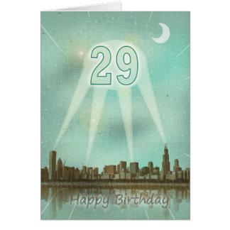 29th Födelsedagkort med en stad och strålkastarear Hälsningskort