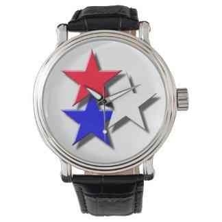 3 stjärnor som är röda, vit, blått armbandsur