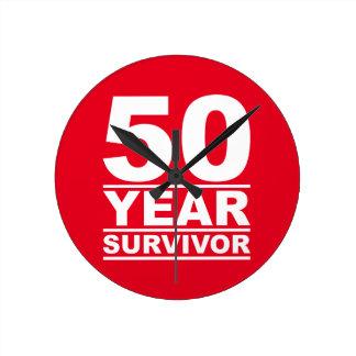 50 år överlevande rund klocka