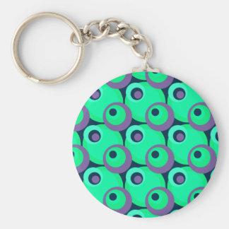 70-tal som överlappar disko, cirklar grönt och vio rund nyckelring