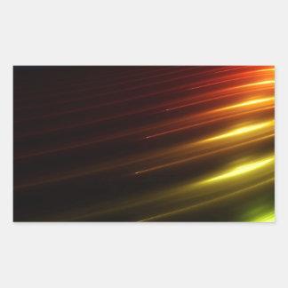 Abstrakt färgar strålen av ljus rektangulärt klistermärke