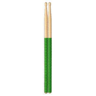 Abstrakt gröna drumsticks trumpinnar