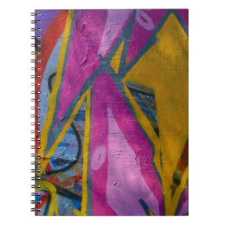 Abstrakt moderiktiga grafitti tätt upp fotografisk anteckningsbok