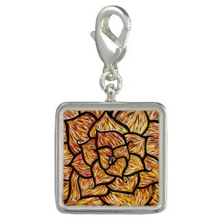 Abstrakt orange blomma berlock