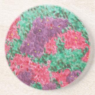 Abstrakt vattenfärgvägg av bougainvilleaen glasunderlägg i sandsten