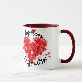 Adoption kommer med kärlekkaffemuggen