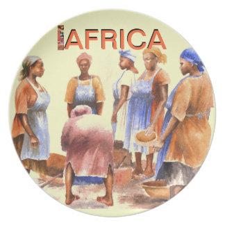 Afrikan pläterar vid Mojisola en Gbadamosi Okubule Tallrik