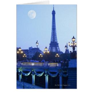 Aftonen beskådar av det Eiffel torn på moonrise Hälsningskort