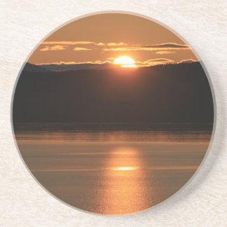 Alaska solnedgång - reflektera av hav underlägg
