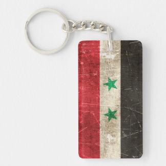 Åldras och skrapad flagga för vintage av Syrien