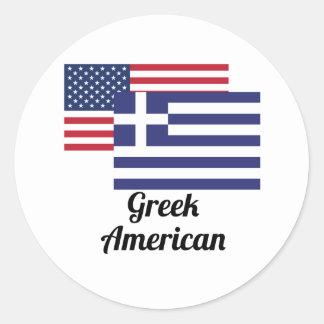 Amerikan och grekisk flagga runt klistermärke