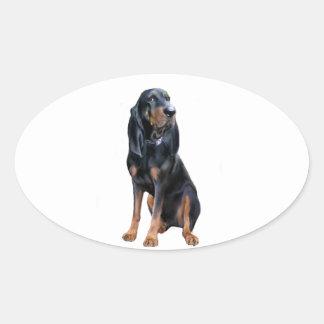 AmerikanCoonhund - svart och solbränna Ovalt Klistermärke