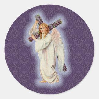 Ängel med en kor med en glödande gloria runt klistermärke