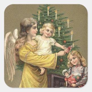 Ängelbarn och julgran fyrkantigt klistermärke