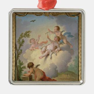 Änglar som leker med en fågel i en landskap julgransprydnad metall