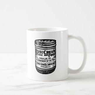 Annonsering för vintagebystkräm kaffemugg