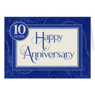 Anställdårsdag 10 år - text virvlar runt blått hälsningskort