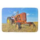Antik orange traktor för badmatta badrumsmatta