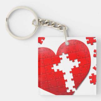 Arg pusselnyckelring för hjärta