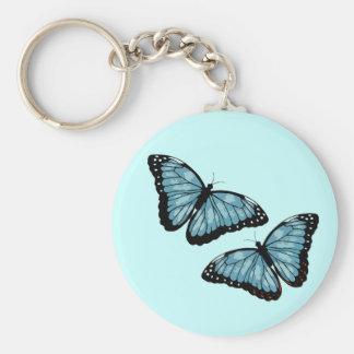 Artsy blåttfjärilar rund nyckelring