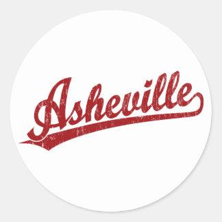 Asheville skrivar logotypen i rött runt klistermärke