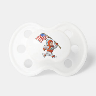 Astronaut med amerikanska flaggan napp