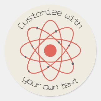 Atomen strukturerar runt klistermärke