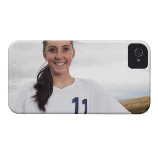 att le tonåring flickafotbollspelare med iPhone 4 Case-Mate fodral