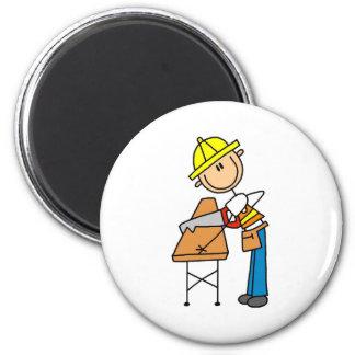 Att såga för byggnadsarbetare stiger ombord magnet