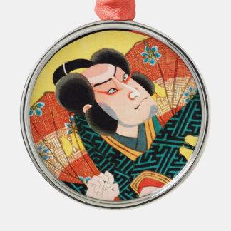 Avbilda av kabukiskådespelare på den hopfällbara julgransprydnad metall