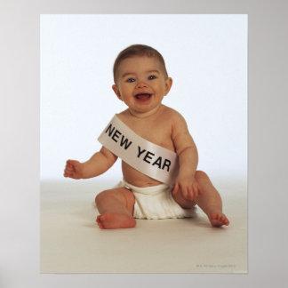 Baby med fönsterramen för nytt år poster