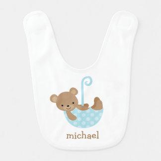 Babybjörn i blåttparaply hakklapp