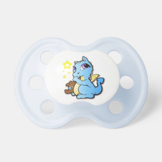 Babydrake som suger hans tum - blått - nappar