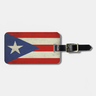 Bagagemärkren med smutsar ner flagga från Puerto R Bagagebricka