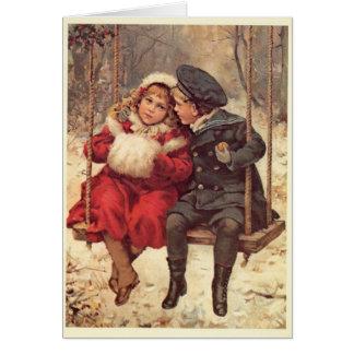 Barn på jul för en gunga hälsningskort