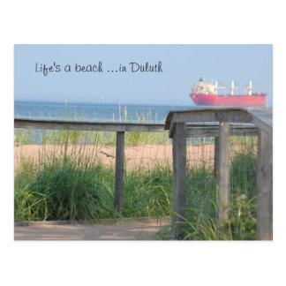 Beachwalk liv är en strand… i Duluth Vykort