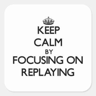 Behållalugn, genom att fokusera på att spela igen fyrkantigt klistermärke