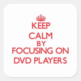 Behållalugn, genom att fokusera på Dvd spelare Fyrkantiga Klistermärken