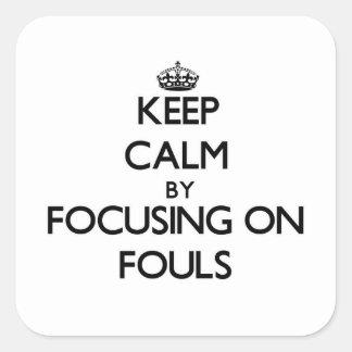Behållalugn, genom att fokusera på ojust spel fyrkantigt klistermärke