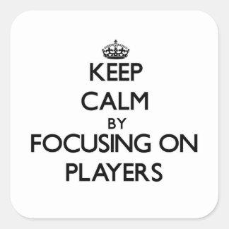 Behållalugn, genom att fokusera på spelare fyrkantiga klistermärken