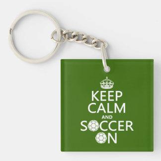 Behållalugn och fotboll på nyckelkedjor