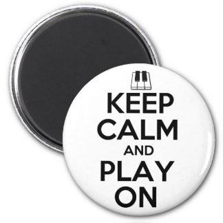 Behållalugn och lek på piano magnet