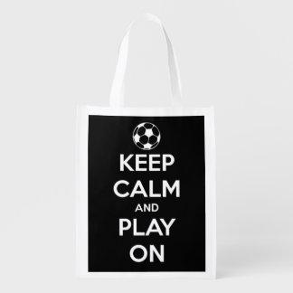 Behållalugn och lek på vit på svart fotboll återanvändbar påse