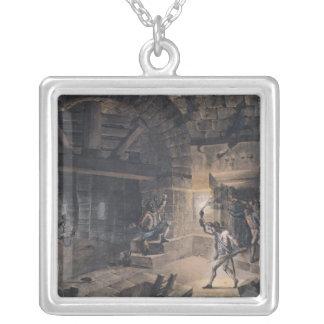 Beskåda av en cell i bastillen silverpläterat halsband