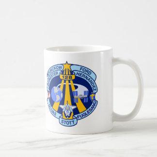 Beskickningen STS-128 lappar Kaffemugg