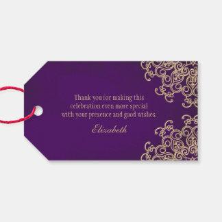 Beställnings- lilor och indisk stil för guld presentetikett