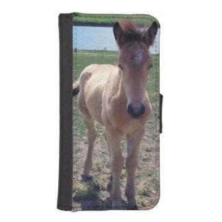 Bild av hästar - ett ungt hästfölanseende mobil plånbok