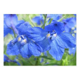Blåa blommor som handlar kortet visitkort