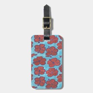 Blått och röd hibiskusbagagemärkre bagagebricka