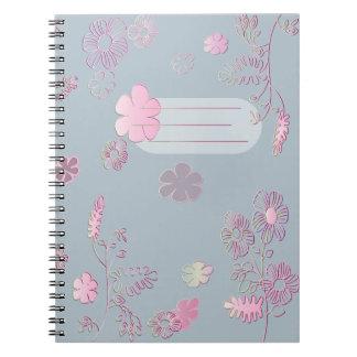 Blått- och rosaanteckningsbok anteckningsbok med spiral